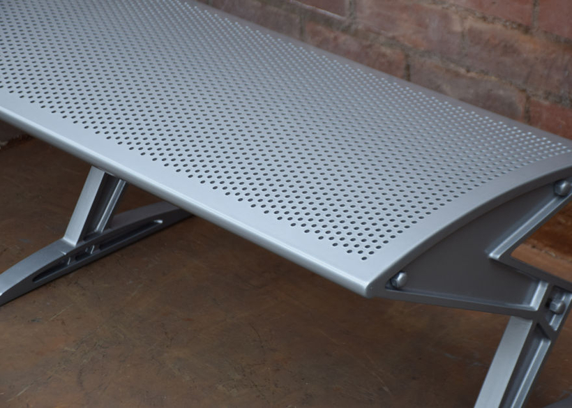 with sleek supports and perforated seating